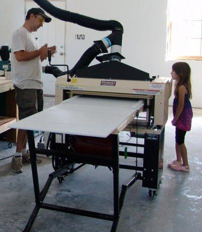 """Here's Mike and his Woodmaster with his #1 helper, his daughter Loren, 7. """"She wants me to make her a race car,"""" he says."""
