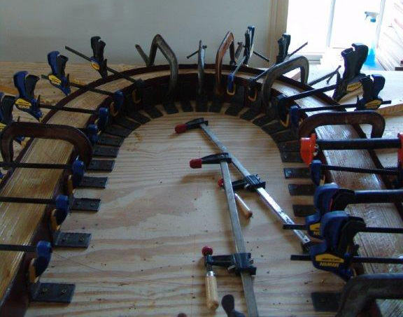 """Curved arches are not a beginner's task but I'd planned on making them before I bought the Woodmaster,"" says Mike. ""I had someone quote what it would cost to build them. I said, 'No, we're not paying that.' The Woodmaster came with a video on how to make your own curved molding. I followed the video's instructions to the letter and it worked out well."""
