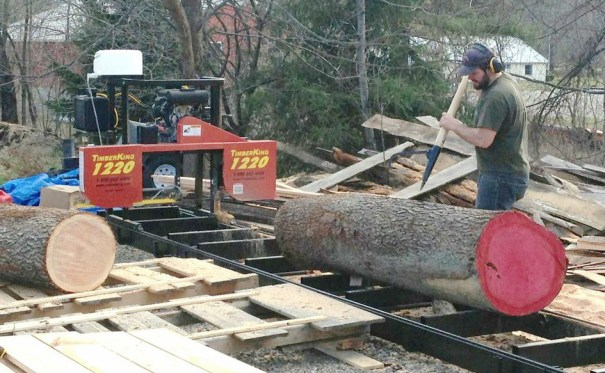 "Eli bought a TimberKing 1220 sawmill to mill lumber from his own trees. ""It did everything I needed it to do,"" he says. TimberKing and Woodmaster are sister companies out of Kansas City, Missouri."