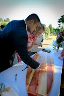 """Please be sure to sign our...surfboard!"" Guest books are so yesterday. Guests at weddings and affairs sign one of Dana's surfboards."