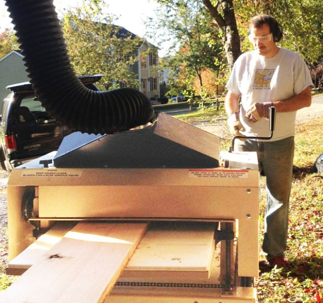 Eric Esiason ran thousands of board feet through his Woodmaster Molder/Planer. Here he's planing oak trim for the new home he and his family built.