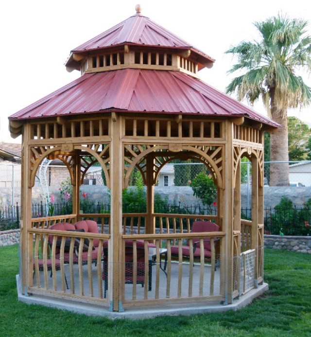 """Here's a 12' gazebo Ed built using his Woodmaster Molder/Planer. """"It's made from rough sawn Redwood I planed with my Woodmaster,"""" he tells us. """"It's my own design and I put lots of work into all the details, dado joints, curved rails, and CNC-carved star medallions."""""""