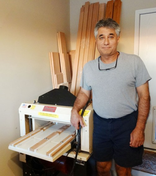 A man and his Woodmaster! Here's Ed with his 718 Woodmaster Molder/Planer. He's ready to make molding and trim with the machine set up as a molder and plenty of cherry blanks on hand.
