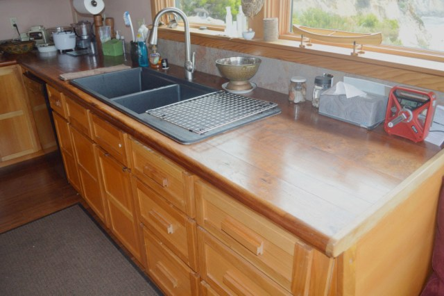The Phelps made their kitchen cabinets of Monterey Cypress, and made the counter tops of Mesquite. Beautiful!