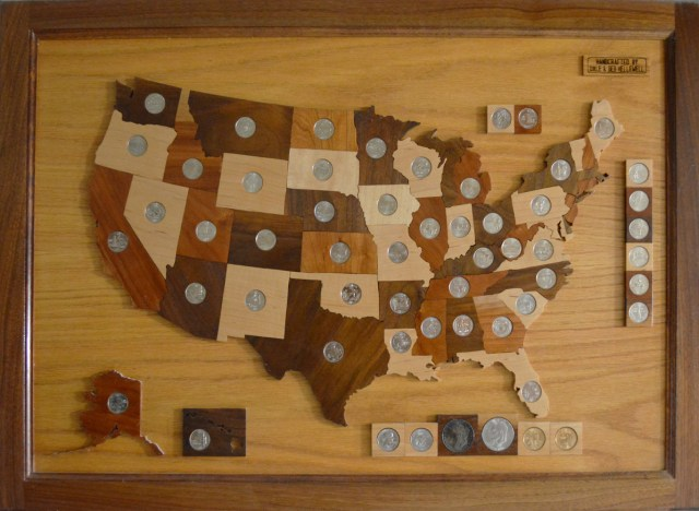 Every state has a quarter, and every quarter's in its state in Dale's handmade, all-wood, laser cut USA map. He starts every project by planing wood flat on his Woodmaster Molder/Planer.