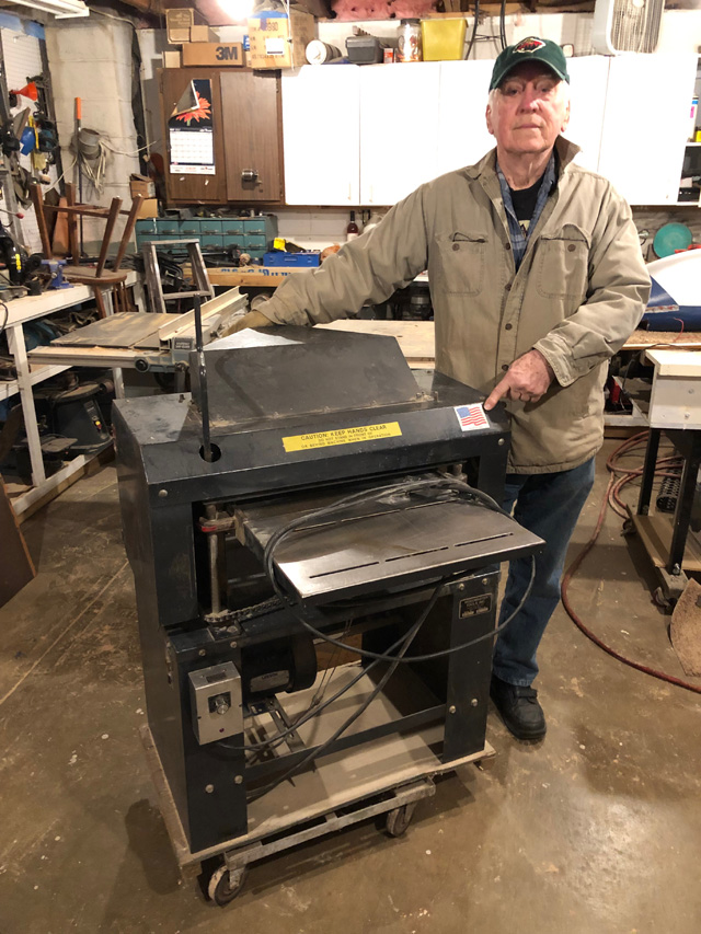"Back in the 1980's, we painted Woodmaster Molder/Planers dark blue. That's when Robert Lewis got his machine. 30 years later, Robert's machine still runs like a top. In the photo, Robert points to our ""Made in USA"" sticker. That's a big reason many people choose Woodmaster."