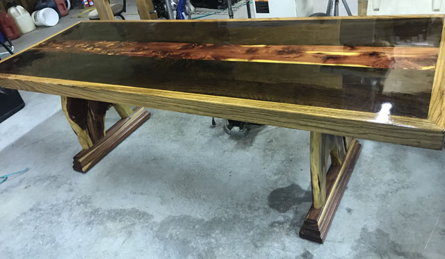 Here's a nice big table with live edge legs. These folks make all the tops and the legs, too, some legs are of welded steel.