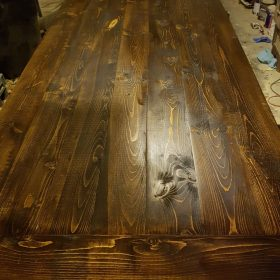 Jacobean stained table top shows wood grain