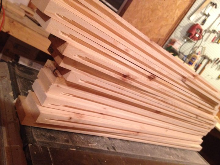 """Stack of cabinet door frame pieces with 1/4"""" dadoes cut for panels"""