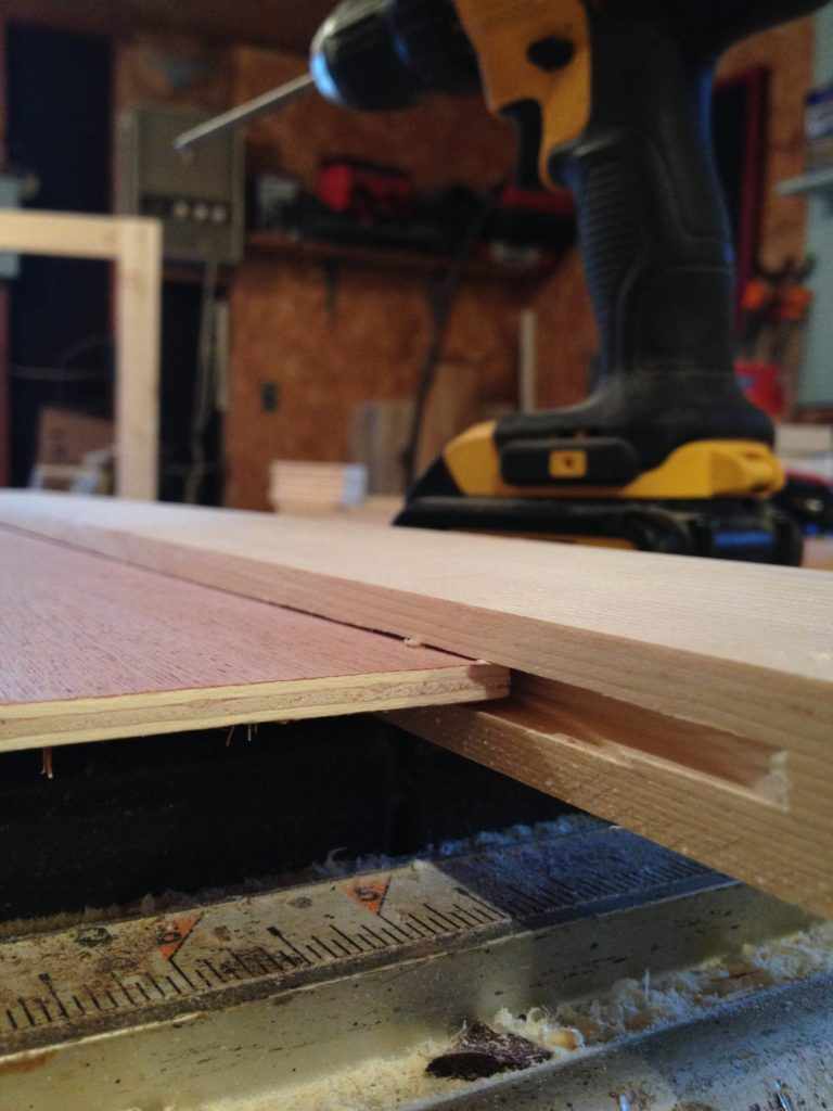 "1/4"" plywood panel sitting in 1/4"" dado cut on door frame pieces"