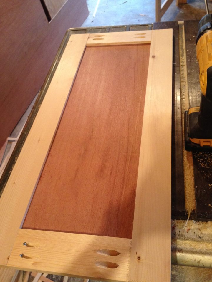 Shaker cabinet doors assembled with pocket holes and screws on back side of door
