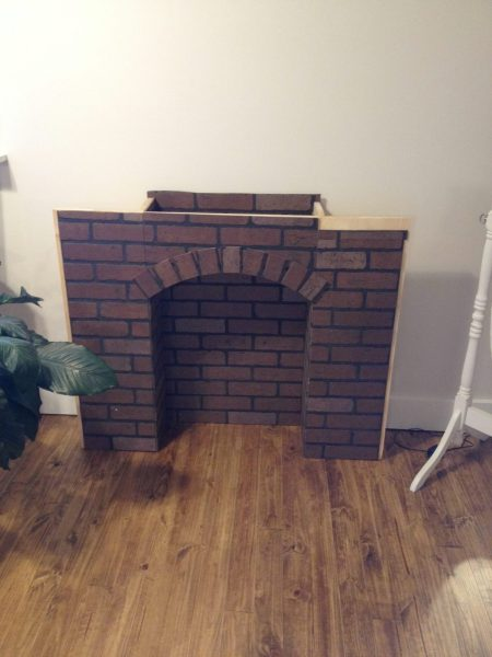 If You re Going to Make It  You Better Fake It  DIY Fake Brick Fireplace For the arch  I cut individual bricks out and cut them in half and just  nailed them along the arch  Don t worry about gaps between them