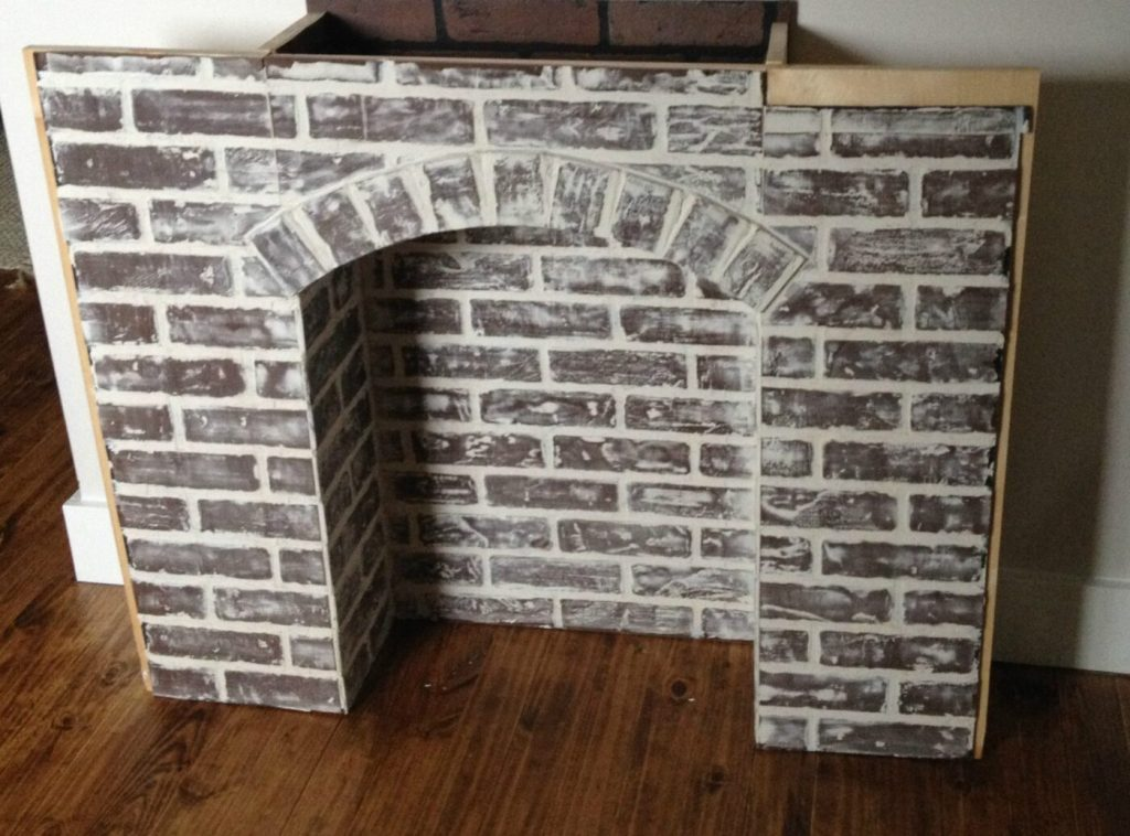 If Youre Going To Make It You Better Fake It Diy Fake Brick Fireplace