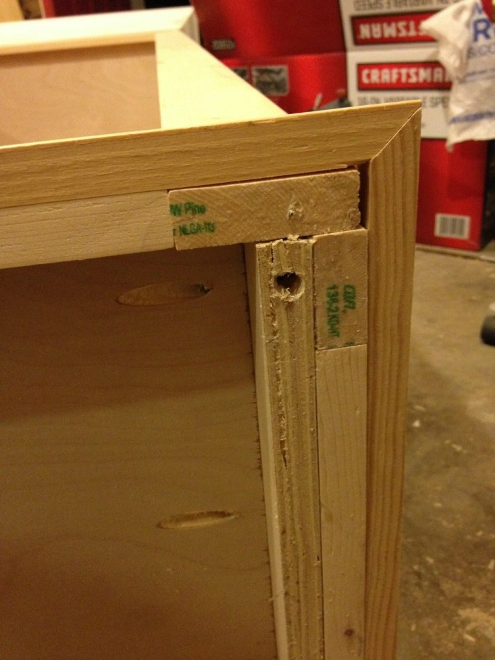 Predrilled hole on bottom of bookshelf to install screw dowel to attach feet