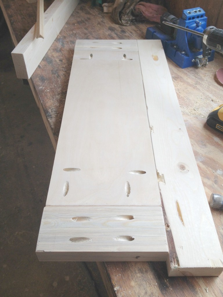 Middle plywood panel of cabinet side installed with pocket holes