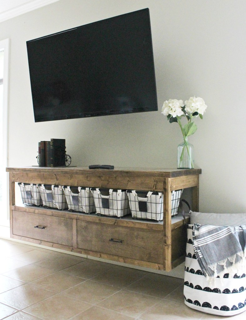 Free building plans to build your own modern DIY TV Console table. With plenty of storage, plus functionality, this modern TV Console is easy to build and stained in a gorgeous minwax provincial. Perfect for a living room, kids playroom, or even a bedroom.