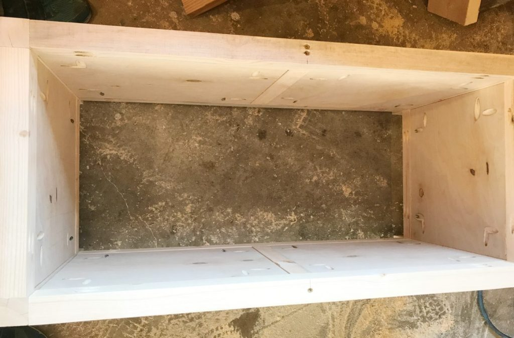 Add side panels to the DIY storage chest frame