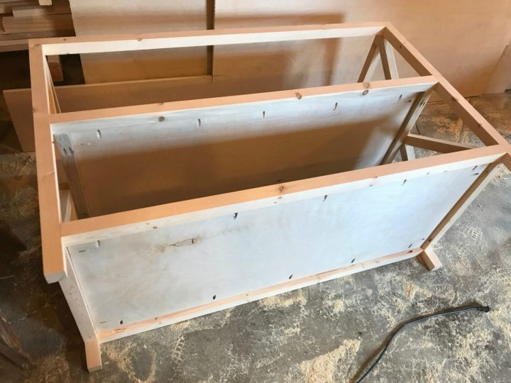Add plywood shelves to x base console table