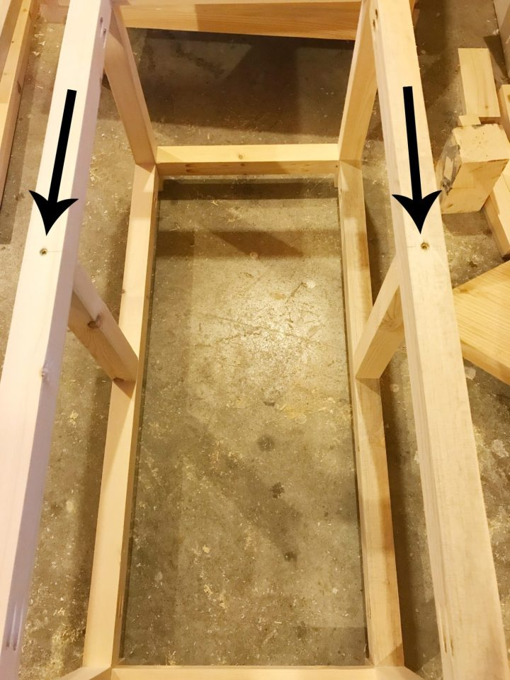 Screw middle dividers into DIY storage chest frame