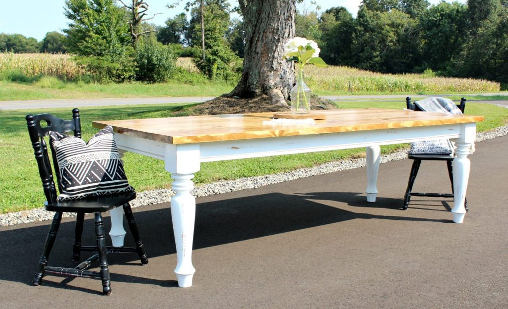Check out this beautiful distressing on this easy to build DIY Farmhouse Dining Table--get the free building plans here