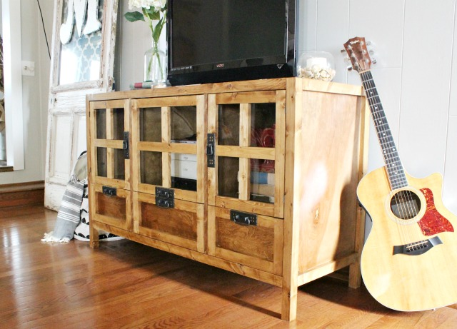 How to build a modern DIY media console cabinet with glass doors, and drawers for storage!