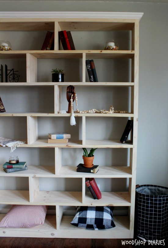 Simple, modern unfinished wooden DIY bookshelf with alternating shelf dividers