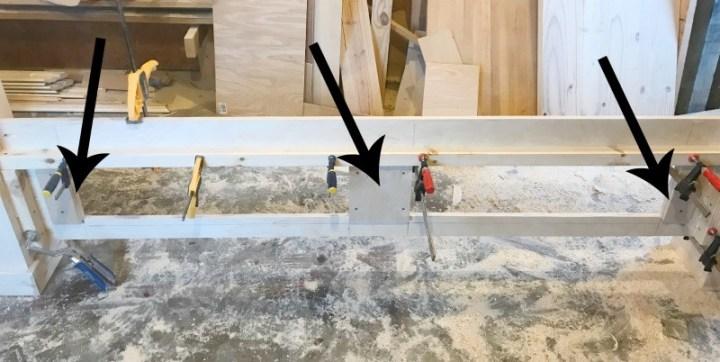 Scrap wood blocks on foot board to attach framing