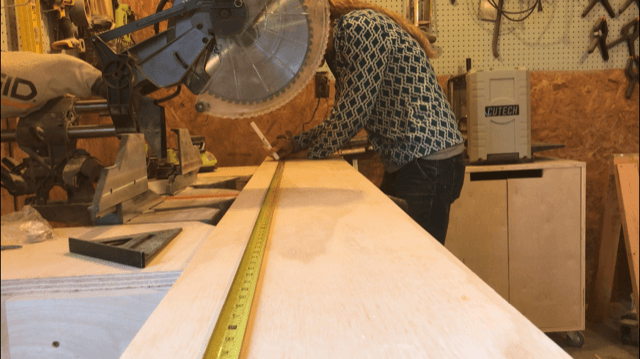 Measuring to cut plywood strip for bookshelf sides