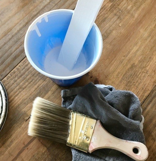 How to whitewash wood--white paint and paintbrush
