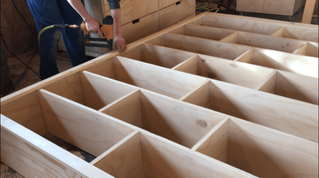 Nailing face frame onto DIY modern stand alone bookshelf