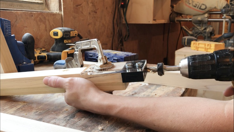 Drill dowel holes into end of frame pieces for modern nightstand assembly