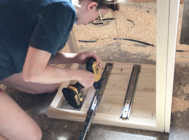 Screw drawer slides onto body of diy modern nightstand