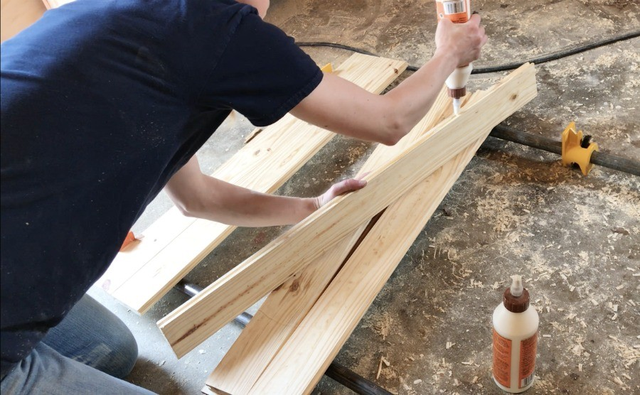 glue up tongue and groove boards to create diy wooden stove top cover top