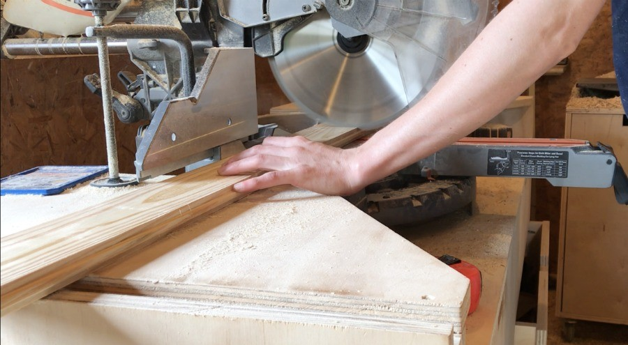 cut boards to glue up stove top cover top on miter saw
