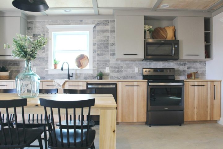 Modern kitchen cabinets installed into gray and wood kitchen