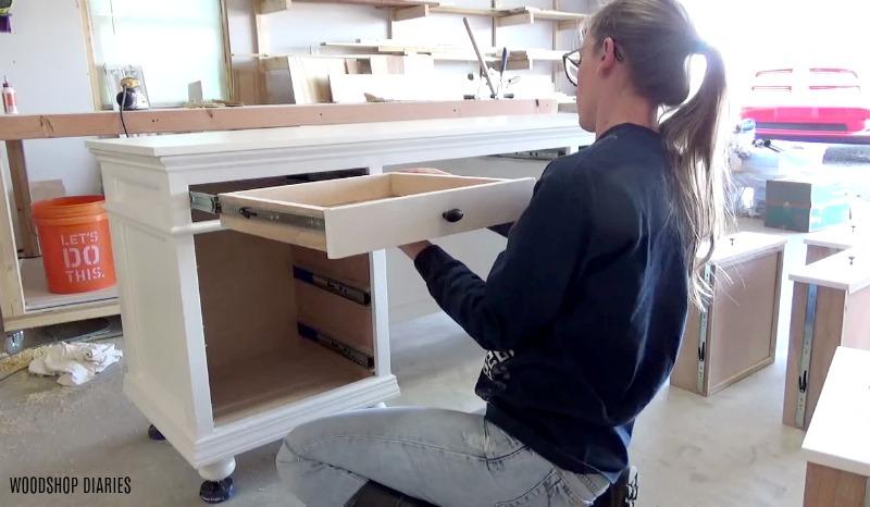 Shara Woodshop Diaries installing drawer into top of DIY storage desk