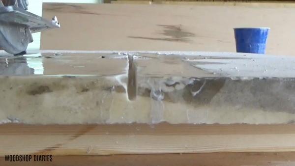 Diamond blade cutting halfway through marble