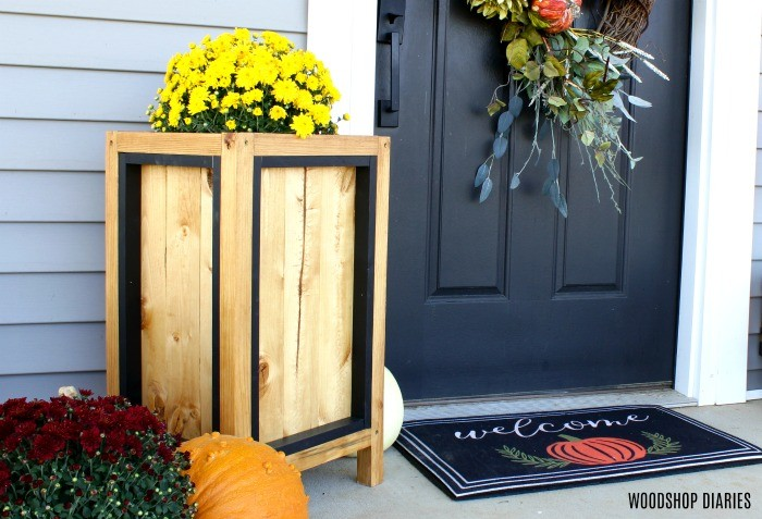 Fall project idea #5: a simple wood and black planter box with a mum by the front door