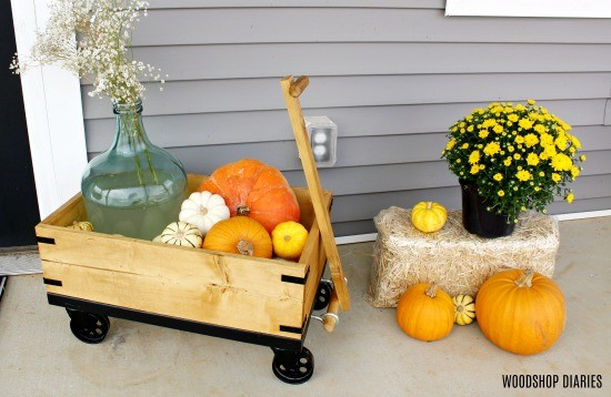 DIY Wooden Wagon on front porch with pumpkins and mums