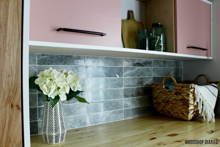 Butcher block counter top and backsplash in laundry room nook