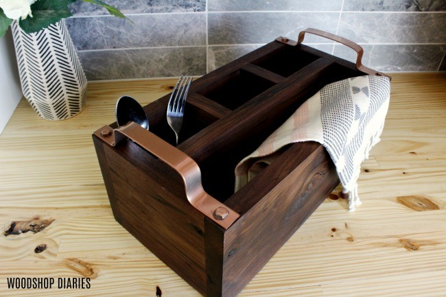 Overhead view of DIY wooden flatware caddy box with metal rose gold handles