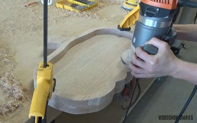Using a flush trim bit in router to clean edges on a glued up platter project