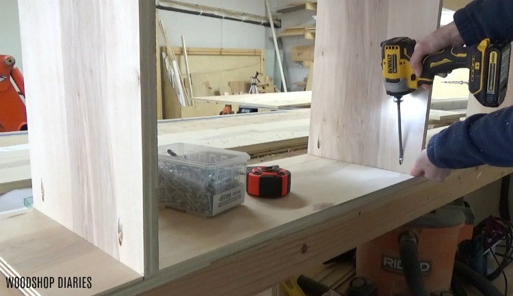 Screwing together side cabinet carcass for entertainment center