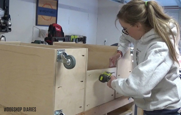 Screw in bottom shelf of DIY mobile miter saw stand