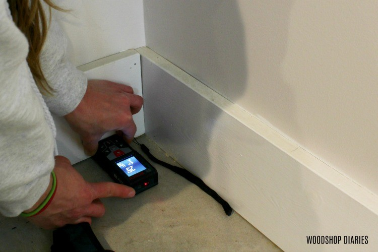 Bosch Laser Measurer to measure first row of LifeProof Vinyl Plank Flooring