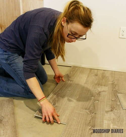 Installing starter piece onto row of LifeProof Vinyl Plank Flooring