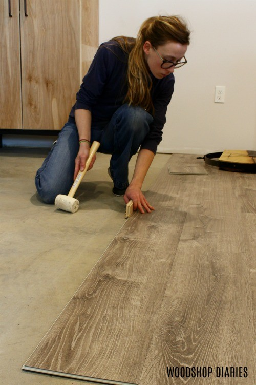 Tap LifeProof Vinyl Flooring Tight with tapping block