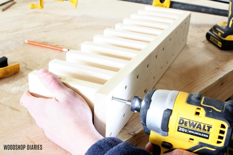 drive last screw to attach clamp rack divider blocks