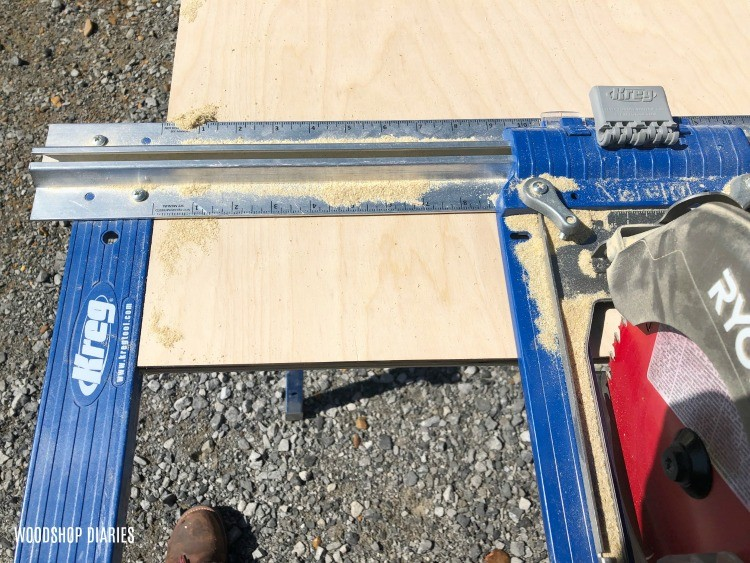 Line rip cut straight edge guide up with edge of plywood sheet