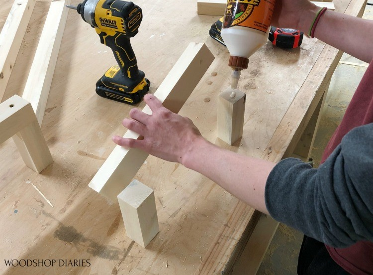 Applying glue to short towel rack pieces before adding screws